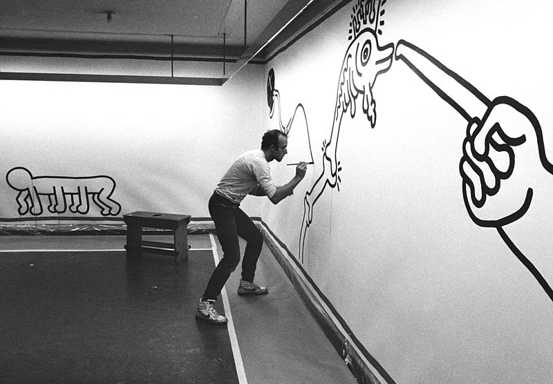 Keith Haring mid-painting in 1986.
