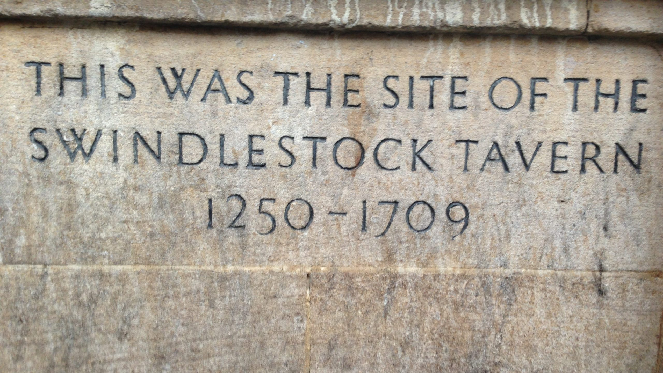 Inscription showing the site of the Swindlestock Tavern, one of Oxford's historic pubs.