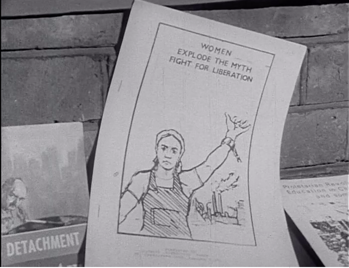 A poster from the event reading 'women...explode the myth, fight for liberation'.